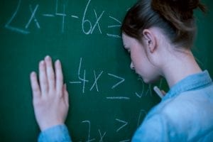 Teen girl with math troubles