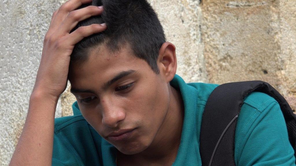 Depressed Hispanic teen